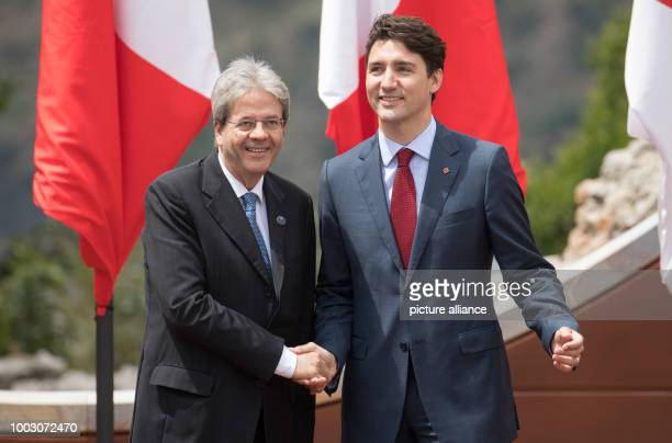 Italy's Minister President Paolo Gentilono welcomes Canada's Prime Minister Justin Trudeau at the G7 summit in Taormina in Sicily Italy 26 May 2017...