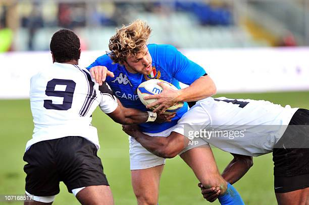 Italy's Mirco Bergamasco vies with Fiji's Nemia Kenatale and Vereniki Goneva during their the Test match at the Braglia stadium in Modena on November...