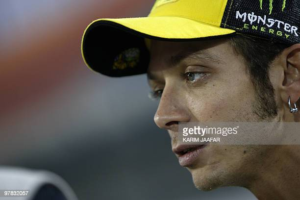 Italy's MotoGP rider Valentino Rossi of Fiat Yamaha Team waits for the start of the final preseason test at the Losail International Circuit in the...