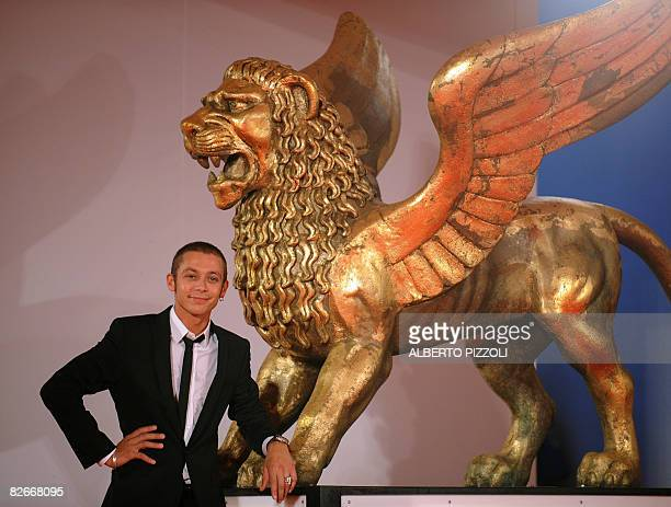 Italy's MotoGP rider Valentino Rossi poses before the screening of the movie Yuppi Du at the 65th Venice International Film Festival in Venice Lido...
