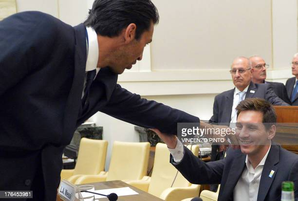 Italy's national football team captain Gianluigi Buffon salutes Argentina's national football team forward Lionel Messi during a humanity initiative...