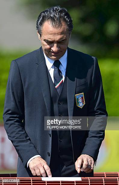 Italy's national football team coach Cesare Prandelli checks his position as he waits prior to a team group photo at Florence's Coverciano training...