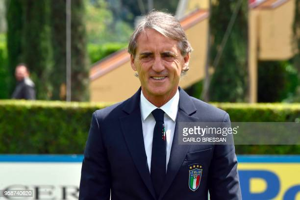 Italy's national football team newly appointed head coach, Roberto Mancini poses after a press conference on May 15, 2018 at the national team's...