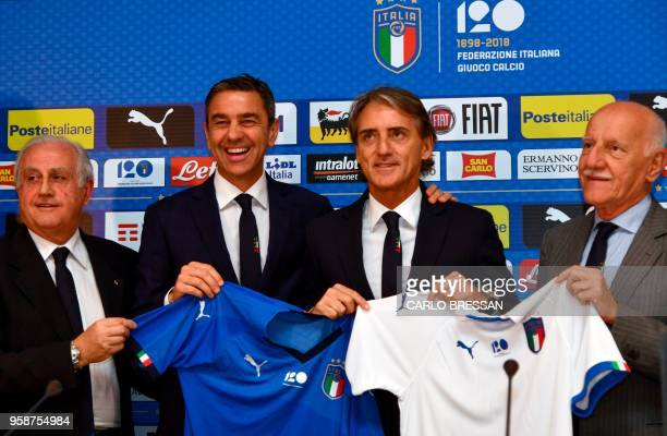 Italy's national football team newly appointed head coach Roberto Mancini poses with members of the Italian football federation Alessandro Costacurta...