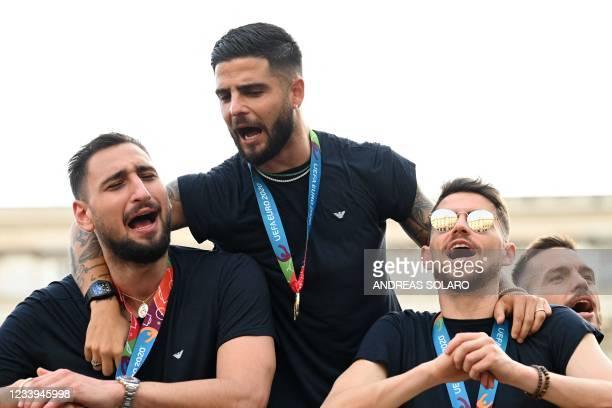 Italy's national football team players Italy's goalkeeper Gianluigi Donnarumma, Italy's forward Lorenzo Insigne, Italy's midfielder Jorginho and...