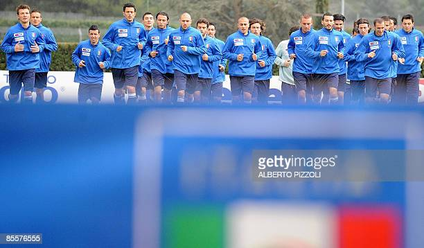 Italy's national football team players warmup during training session at the National Technical Center of Coverciano near Florence on March 24 four...