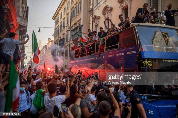 Italy's national men's football team celebrate during an open-top bus victory parade in the streets of Rome, a day after they won the UEFA EURO 2020...
