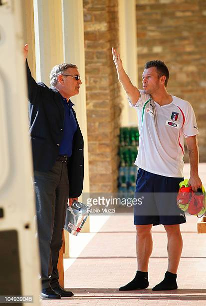 Italy's national player Antonio Cassano speaks to former Italian football player Gigi Riva at the end of a training session on October 7 2010 at the...