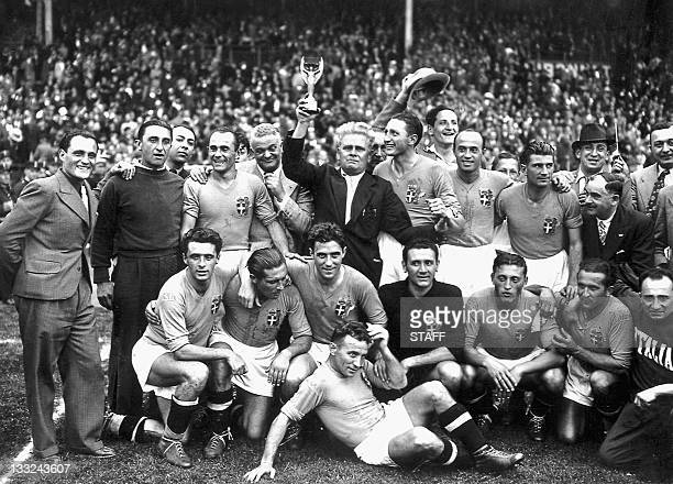 Italy's national soccer team poses with the World Cup trophy after beating Hungary 42 in the World Cup final 19 June 1938 in Colombes in the suburbs...