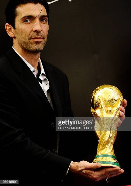 Italy's national team goalkeeper and 2006 world champion Gianluigi Buffon holds the Fifa World Cup trophy in Rome's town hall Campidoglio on March 7...