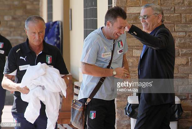 Italy's new national football player Antonio Cassano is greeted by former Italian football player Gigi Riva at the end of the trainning session at...