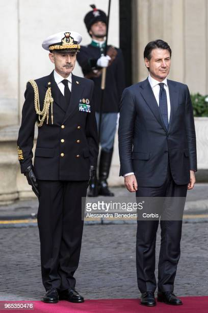 Italy's new Prime Minister Giuseppe Conte salutes italian guard of honour while arriving at Chigi Palace following the oath ceremony of the new...