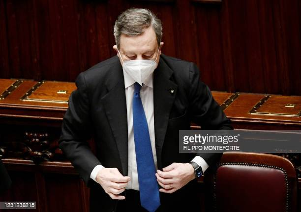 Italy's new Prime Minister Mario Draghi prepares to leave the Lower house of Montecitorio on February 18, 2021 in Rome, after the morning debate...