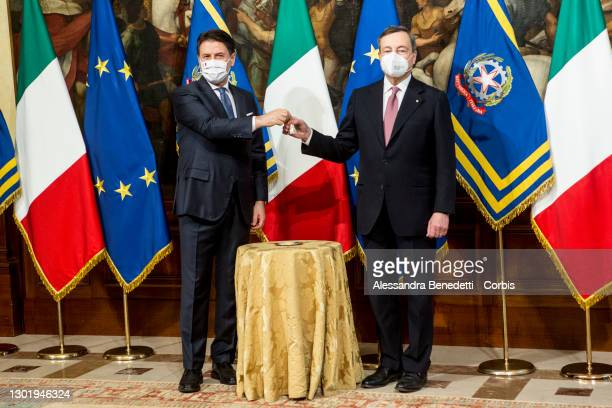 Italy's new Prime Minister Mario Draghi rings the received bell from outgoing Prime Minister Giuseppe Conte, prior the first Ministry Council meeting...