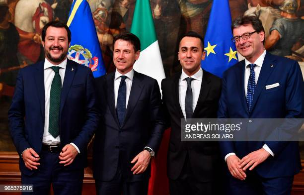 TOPSHOT Italys Newly appointed Prime Minister Giuseppe Conte Italys Interior Minister and deputy Prime Minister Matteo Salvini Italys Labor and...