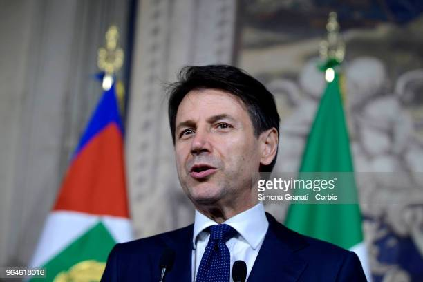 Italy's newly appointed Prime Minister Giuseppe Conte talks to journalists after having received the mandate to form a new government on May 31 2018...