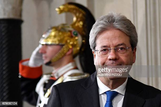 Italy's newly named Prime Minister Paolo Gentiloni arrives for a press conference in Rome on December 11 2016 Gentiloni was named as Italy's new...