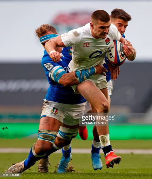 Italy's Niccolò Cannone and Italy's wing Luca Sperandio tackle England's centre Henry Slade during the Six Nations international rugby union match...