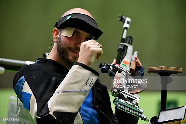 Italy's Niccolo' Campriani reacts during the 10m Air Rifle Men's at the Olympic Shooting Centre in Rio de Janeiro on August 8 during the Rio 2016...