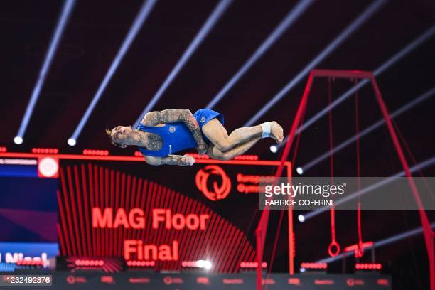 Italy's Nicola Bartolini competes in the Men's floor apparatus final of the 2021 European Artistic Gymnastics Championships at the St Jakobshalle, in...