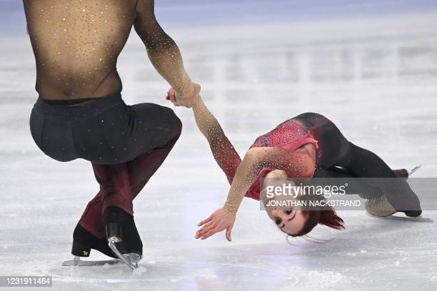 Italy's Nicole Della Monica and Matteo Guarise perform during the pairs' short programme event at the ISU World Figure Skating Championships in...