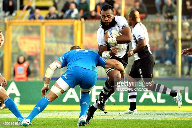 Italy's number 8 Sergio Parisse fights for the ball with Fiji's lock Apisai Naikatini during the rugby test match between Italy and Fiji on November...