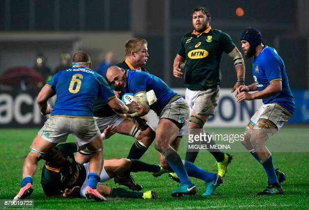 Italys' number 8 Sergio Parisse is tackled by South Africa's flanker PieterSteph Du Toit during a rugby union test match between Italy and South...