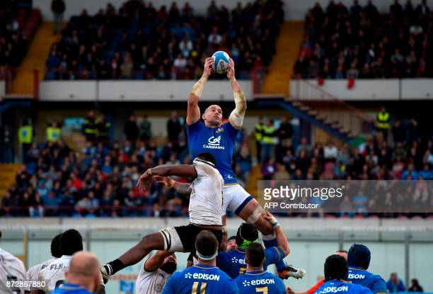 Italy's number 8 Sergio Parisse leaps to catch the ball in a line out during the international rugby union Test match between Italy and Fiji at The...