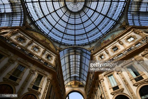Italy's oldest active shopping mall and a major landmark of Milan, Gallery Vittorio Emanuele II is pictured on May 10, 2019. - Housed within a...