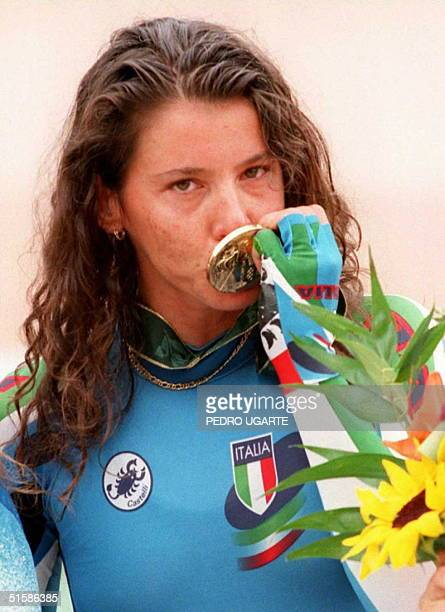 Italy's Olympic team cyclist Antonella Bellutti kisses her gold medal after winning the women's individual pursuit final 28 July on the podium at the...