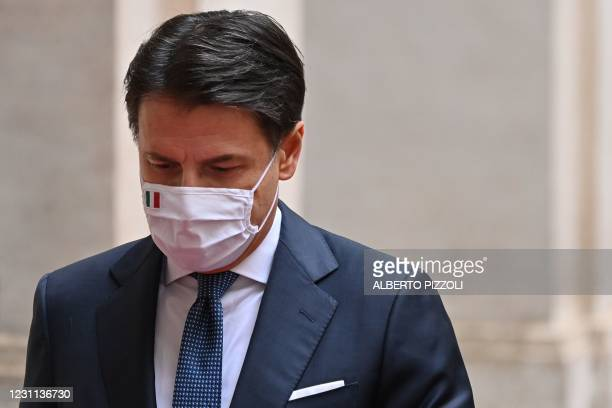 Italy's outgoing Prime Minister, Giuseppe Conte leaves on February 13, 2021 following a formal handover ceremony with incoming prime minister at...