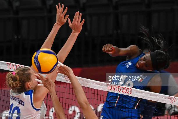 Italy's Paola Egonu spikes the ball in the women's preliminary round pool B volleyball match between Russia and Italy during the Tokyo 2020 Olympic...