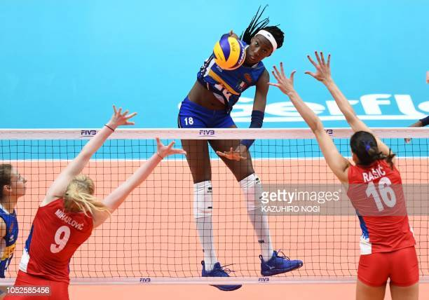 Italy's Paola Ogechi Egonu spikes the ball over Serbia's Brankica Mihajlovic and Milena Rasic during the 2018 FIVB World Championship volleyball...