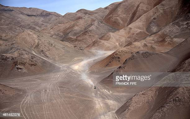 Italy's Paolo Ceci powers his Ktm during 2015 Dakar Rally stage 8 between Uyuni Bolivia and Iquique Chile on January 12 2015 The Uyuni salt flat is...