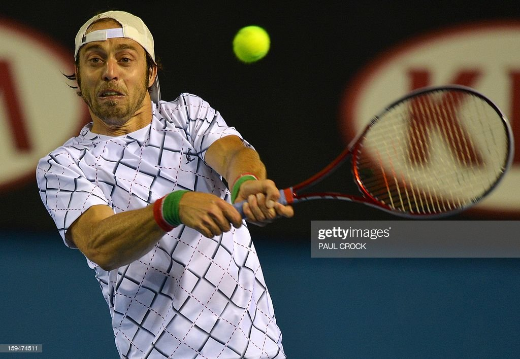 Italy's Paolo Lorenzi hits a return against South Africa's Kevin Anderson during their men's singles first round match on day one of the Australian Open tennis tournament in Melbourne on January 14, 2013.