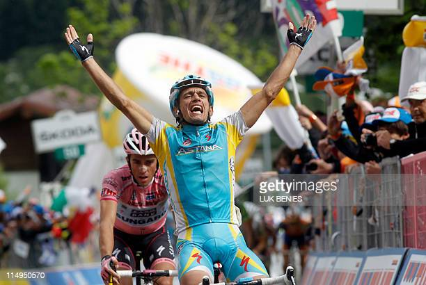 Italy's Paolo Tiralongo celebrates as he crosses the finish line of the 19th stage of the 94th Tour of Italy run from Bergamo to Macugnaga on May 27...