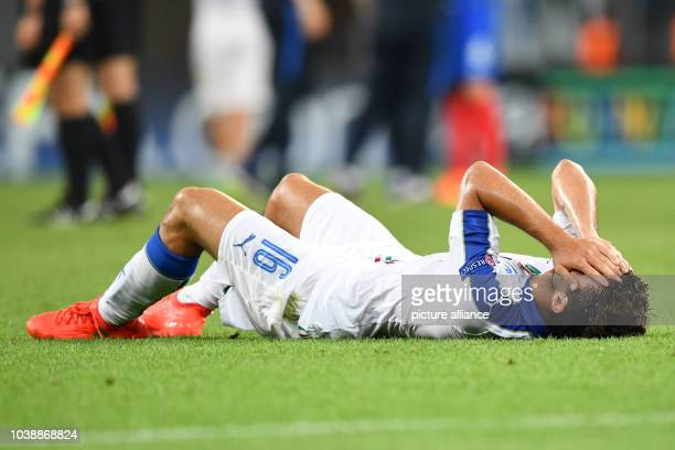 Italy's Patrick Cutrone lies on the pitch after the UEFA European Under19 Championship final soccer match between France and Italy at the...