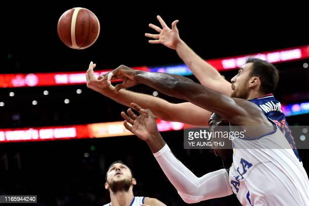 Italy's Paul Biligha and Serbia's Nikola Milutinov fights for the ball during the Basketball World Cup Group D game between Italy and Serbia in...