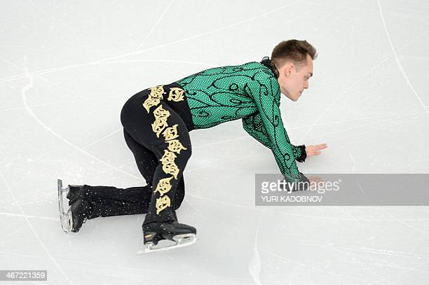 Italy's Paul Bonifacio Parkinson falls during the Men's Figure Skating Team Short Program at the Iceberg Skating Palace during the Sochi Winter...