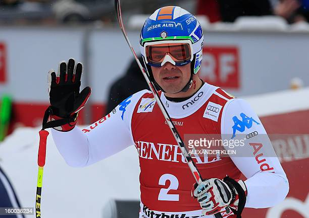 Italy's Peter Fill reacts reacts after the men's World Cup SuperG race on January 25 2013 in Kitzbuehel KLEIN