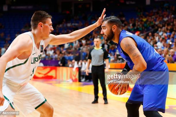Italy's Pietro Aradori is marked by Lithuania's Edgaras Ulanovas during the FIBA EuroBasket championship basketball match between Italy and Lithuania...