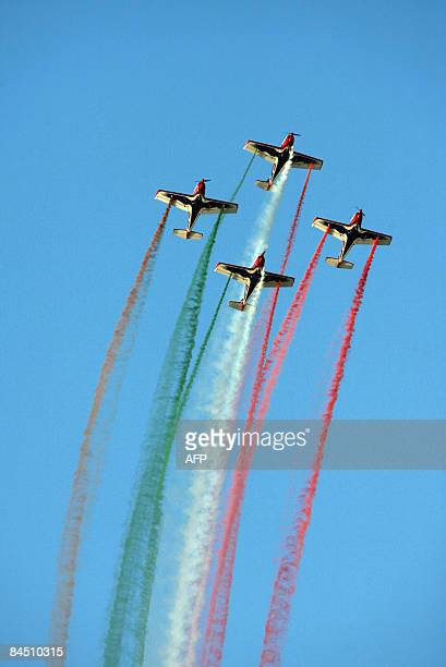 Italy's Pioneer team performs during the AlAin International Aerobatics Show at the Gulf emirate's airport on January 28 2009 AFP PHOTO/KARIM SAHIB