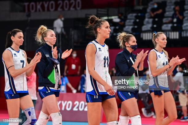 Italy's players applaud after defeat in the women's quarter-final volleyball match between Serbia and Italy during the Tokyo 2020 Olympic Games at...