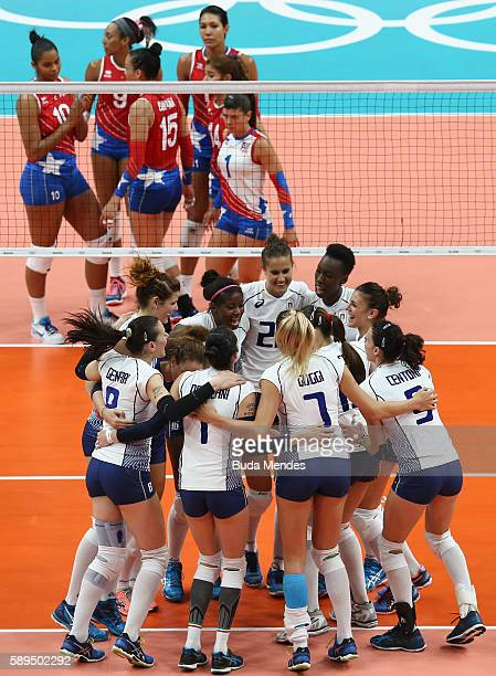 Italy's players celebrate a victory against Puerto Rico during the women's qualifying volleyball match between Italy and Puerto Rico at the...