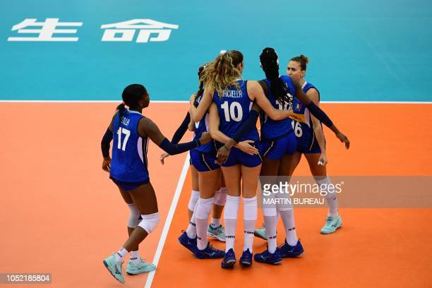 Italy's players celebrate after a point during the 2018 FIVB World Championship volleyball women's pool G match between Italy and Japan in Nagoya on...