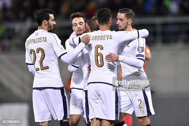 Italy's players celebrate after scoring a goal during the FIFA World Cup 2018 European group G Qualifiers football match beetween Liechtenstein and...