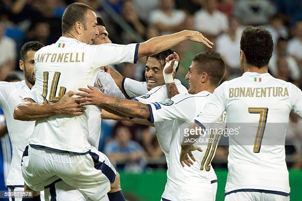 Italy's players celebrate after scoring a goal during their World Cup 2018 qualification match between Israel and Italy at the Sammy Ofer Stadium in...