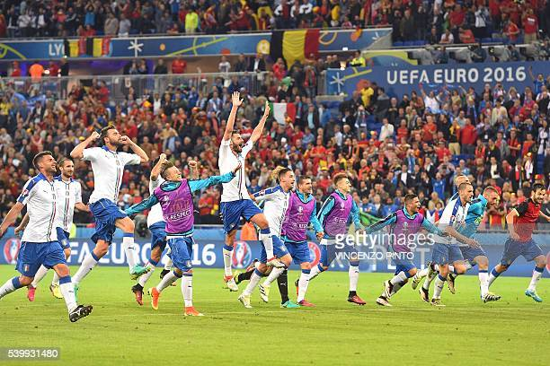 TOPSHOT Italy's players celebrate after winning the Euro 2016 group E football match against Belgium at the Parc Olympique Lyonnais stadium in Lyon...