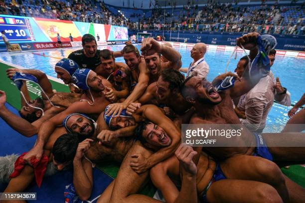 TOPSHOT Italy's players celebrate after winning the men's final match between Spain and Italy of the water polo event at the 2019 World Championships...