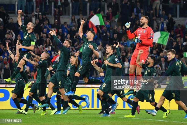 Italy's players celebrate after winning the UEFA Euro 2020 Group J qualifier football match between Italy and Greece at the Stadio Olimpico stadium...